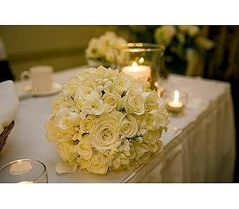 Please visit our website, www.thegardenofedenflowers.com, to view more photos of our actual designs....