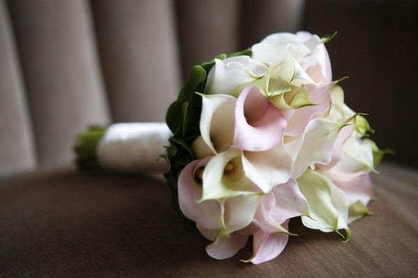 Please visit our website,www.thegardenofedenflowers.com, to view more of our actual wedding designs....