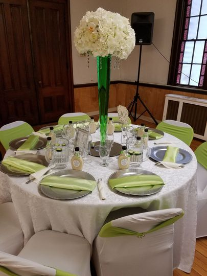 Raised floral centerpiece and green accents