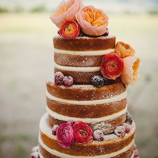 Wedding cake with flowers and berries
