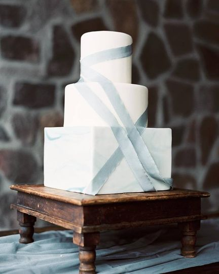 Simple wedding cake with blue ribbons