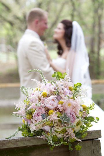 Newlyweds behind their bouquet