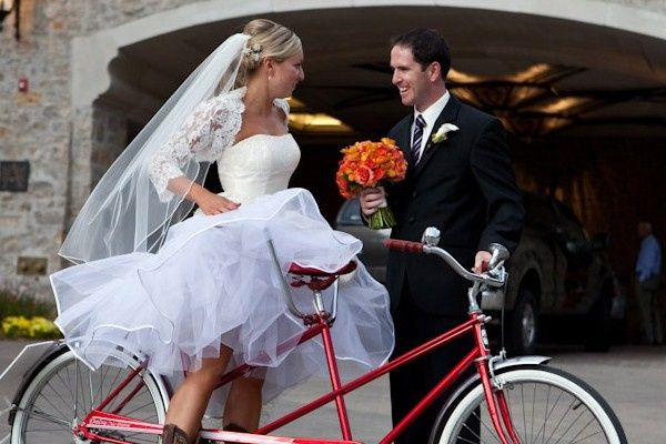 Helping the bride onto the bike
