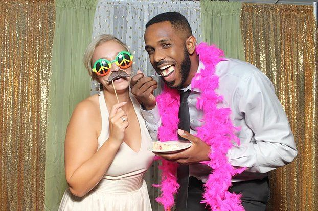 Newlyweds with cake in the booth