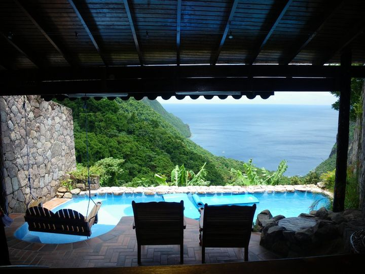 Ladera Resort in luscious St. Lucia from your cliffside escape & plunge pool.