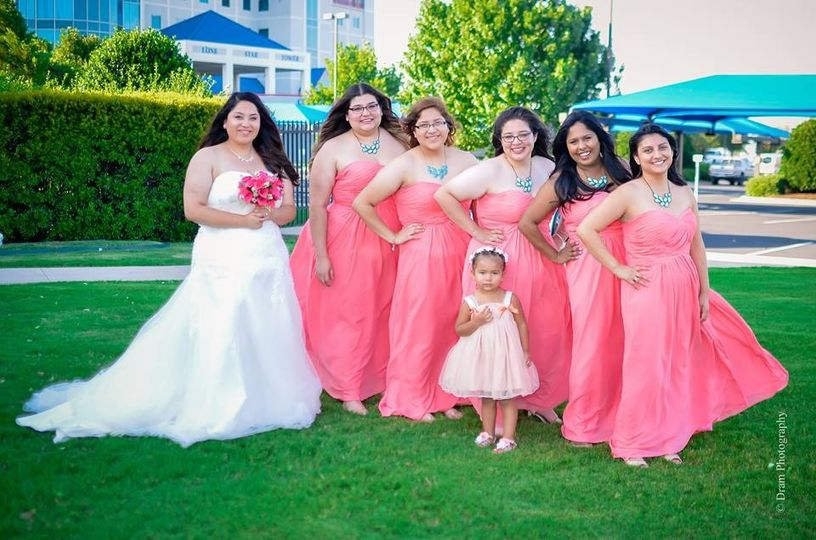 Bride, bridesmaids and flower girl