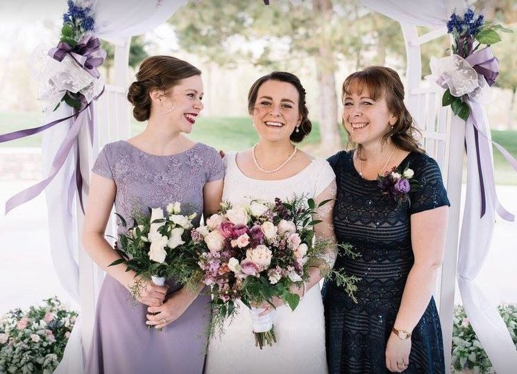 Bride with mother and bridesmaid