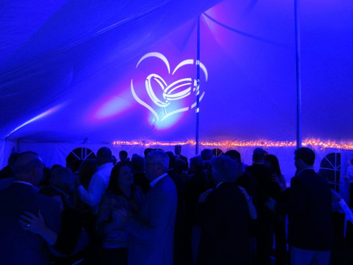 Uplighting and gobo projection on a reception under a tent.  The whole room was bathed in color from...
