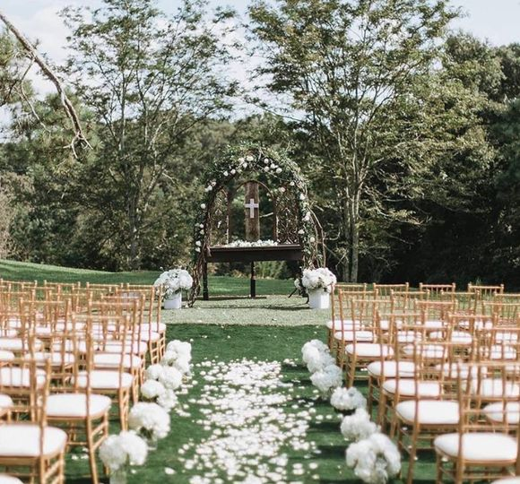 Gold chairs outdoor ceremony