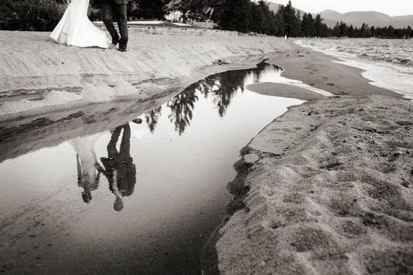 Lake Tahoe bride and groom reflected in a stream at Edgewood