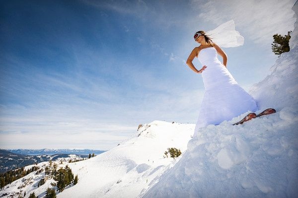 Squaw Valley bride skiing with Lake Tahoe in the background