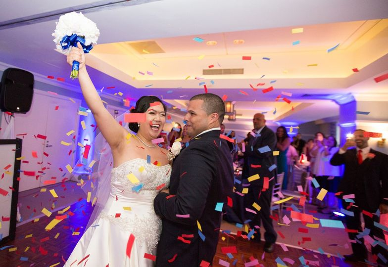 Carlos & michelle having a confetti blast at their wedding that took place at the marriott (south...