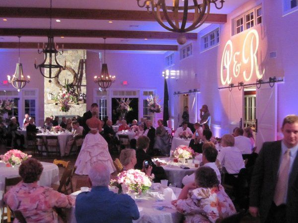 Our pinspots lit all of the tables at this wedding, and the happy couple's initials brightened above...