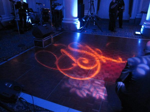 Custom monogram gobo overlaid on a bold, leafy breakup pattern to create a uniqueness on the dance...