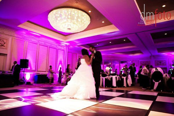 Bright pink uplights brought gave this wedding a loud, fun energy that kept the party going all...