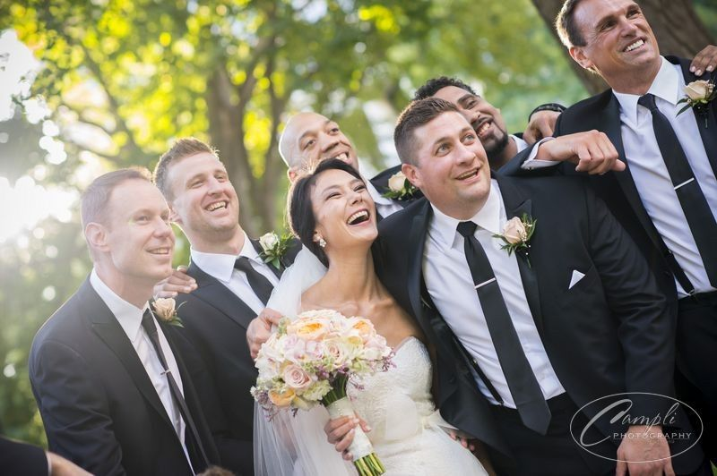 Newlyweds with the groomsmen