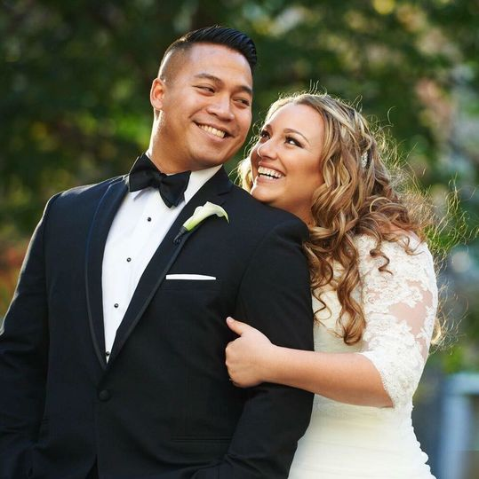Bride holding her groom
