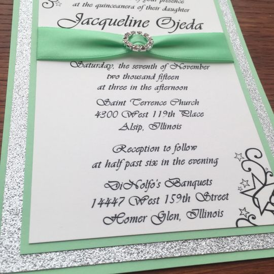 Elegant green ribbon wrap on invitation