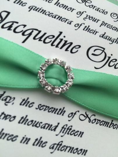 Studded accessory on invitation ribbon