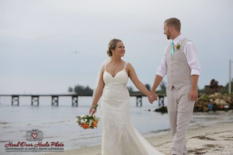 Bride and groom by the beach