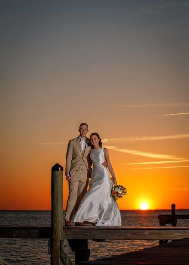 Newlyweds with the sunset in the back