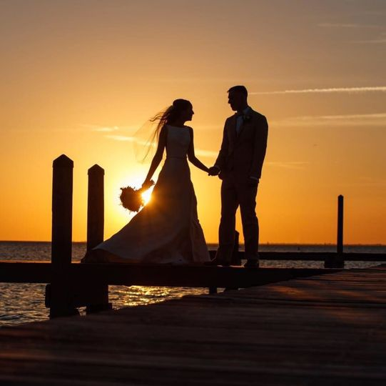 Newlyweds at the dock during sunset