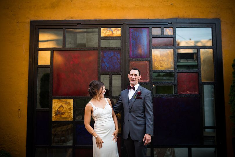 Newlyweds with stained glass backdrop