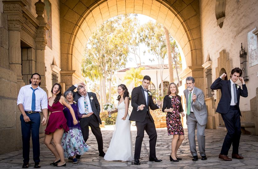 Bridal parties dancing in Santa Barbara courthouse arch, Santa Barbara courthouse wedding photos,...