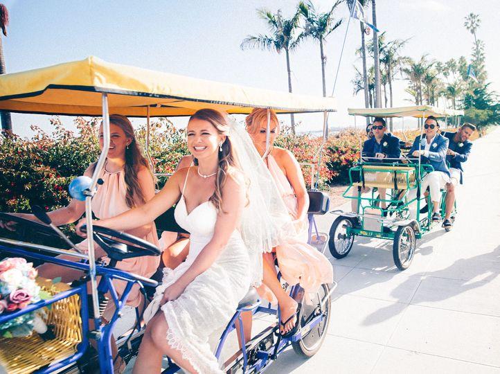 Bridesmaids and groomsmen racing on surreys on Cabrillo boulevard in Santa Barbara. Santa Barbara...