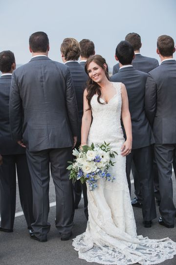 Bridal portrait with groomsmen lining background, Cmarillo Air Museum, Camarillo CA.