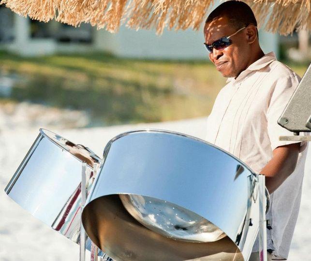 Steel Drum Player at beach wedding ceremony in Panama City Beach Florida.