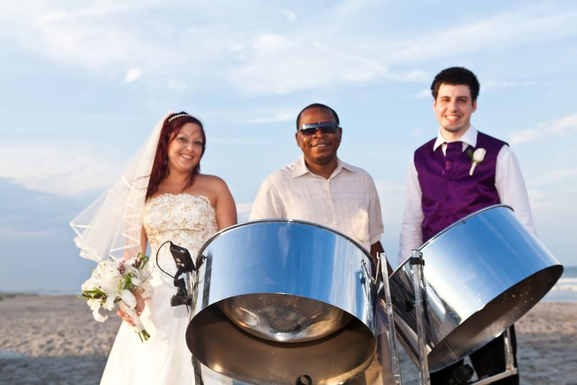Steel Drum Player with bride and groom at beach wedding in Cocoa Beach Florida.