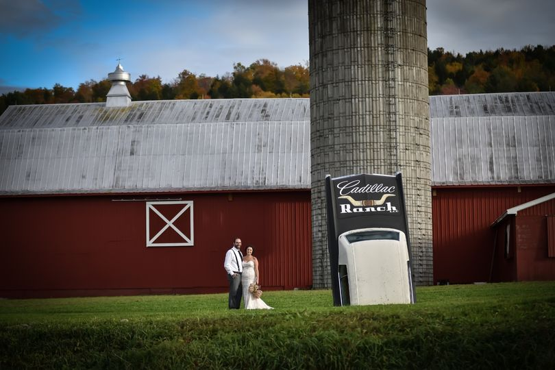 Front of barn and Cadillac