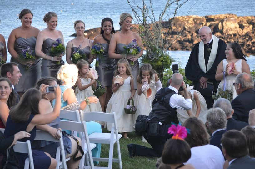 In a Hawaiian tradition, the bride's arrival is announced by the flower girls blowing into conch...