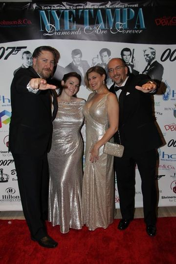 Photo from our last New Years Eve Party @ The Hilton!Yes, we do custom backdrops and red carpet...