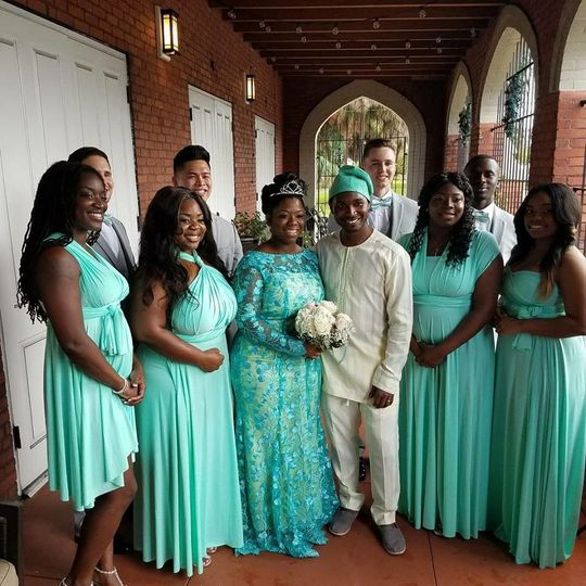 Newlyweds with bridesmaids