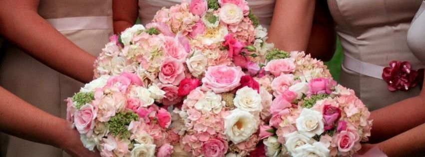 Bridesmaids bouquets in pinks and whites.