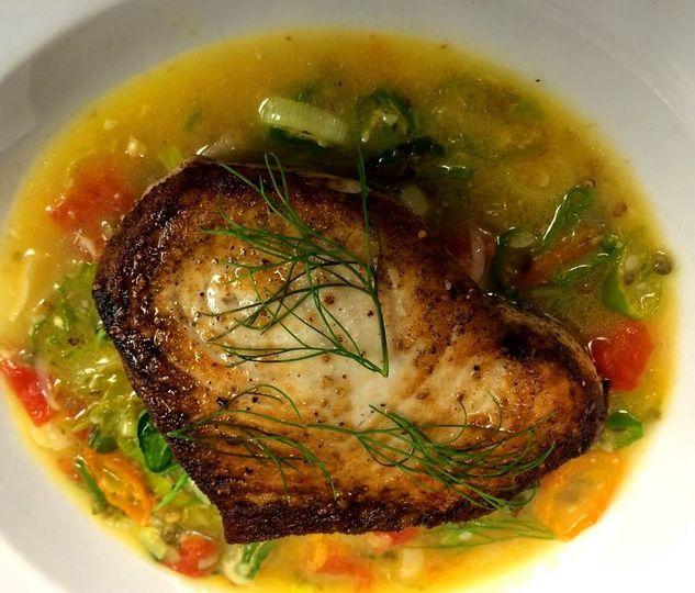 Pan roasted swordfish, roasted cauliflower, leeks, tomatoes, shishito pepper picatta, fennel fronds
