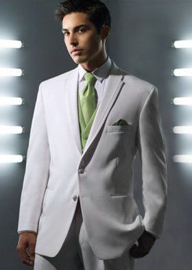 White suit with green tie