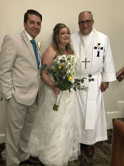 Officiant and newlyweds