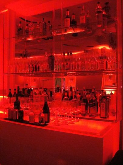 Lighted back bar. At 9 feet tall and 6 feet wide it makes a HUGE statement and provides lots of room...