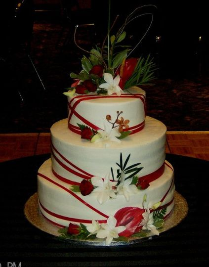 3 tier with thin red ribbon and woodsy flower accents
