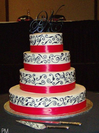 4 tier with pink ribbon and black swirls