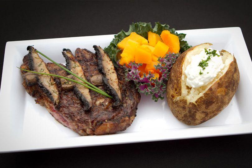 Grilled ribeye & portabella mushroom with baked potato & butternut squash