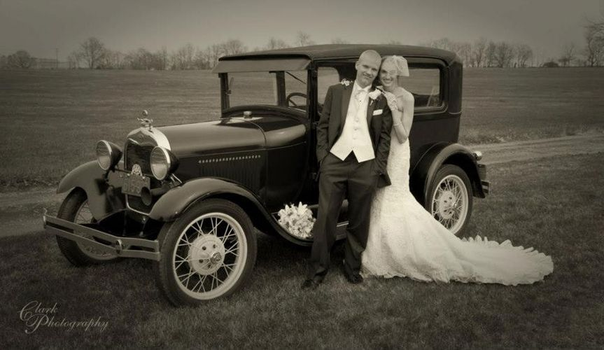 Vintage couple with a 1929 Model A Ford.Photo by Clark Photography