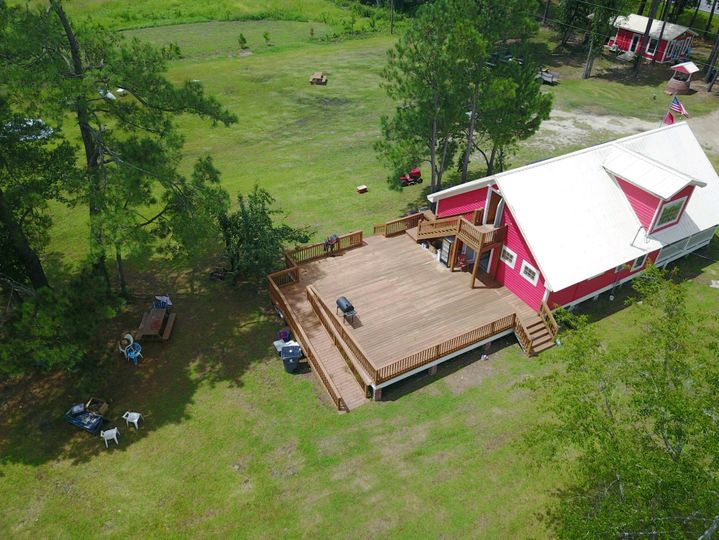 Aerial view of restored century old farmhouse and deck