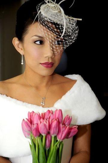 Off-shoulder gown and birdcage veil