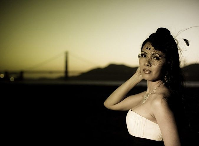 Bride with a bridge in the backdrop