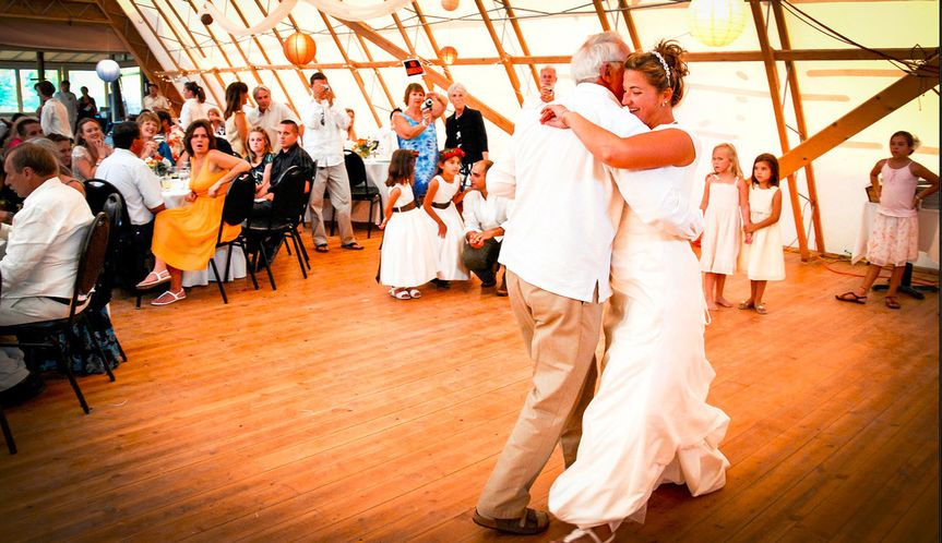 Alison dances with her father George, at the KTAOS Solar Center, Taos, New Mexico