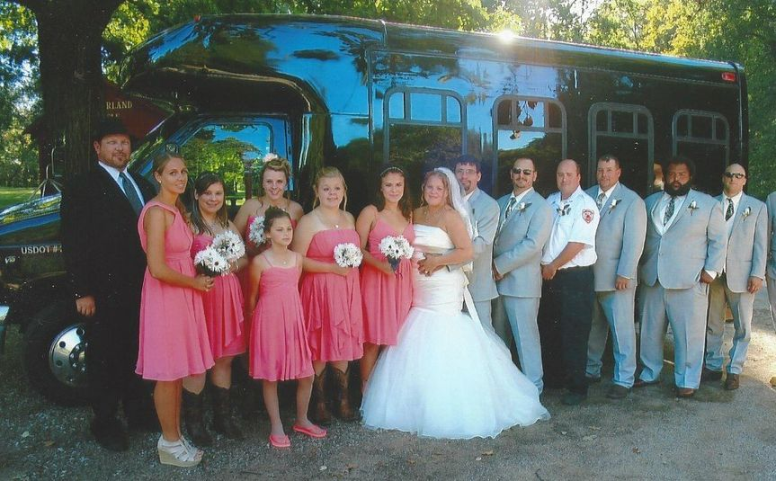 Group photo with limo bus